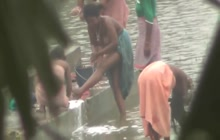 Desi girls taking a bath in the river