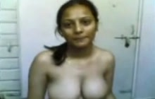 Busty Indian girl gets naked for the cam